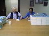 Lester signing copies Plan B 4.0 as gifts with help from Millicent.